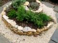 Kräuterspirale bepflanzt